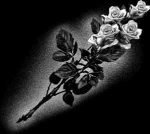 Пример гравировки цветка на памятнике фото