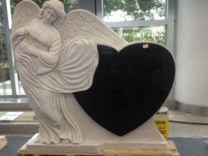 Памятник в виде ангела фото